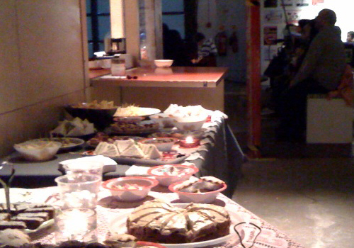 A fairly large spread was put on of cakes & cucumber sandwiches