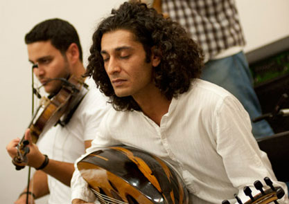 Khyam Allami playing oud with The Alif Ensemble
