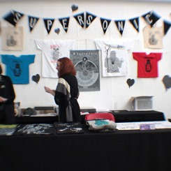 Supersonic merch stall
